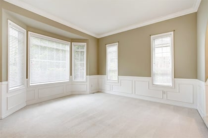 Bright beige room with large windows