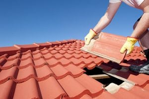Contractor installing a tile roof